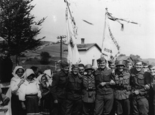 Cheerful German and Slovak soldiers posing with a group of civilians in Komańcza, September 1939.