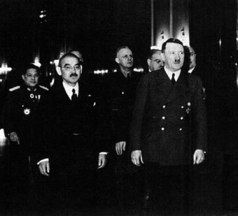 Hitler and the Japanese foreign minister, Yōsuke Matsuoka, at a meeting in Berlin in March 1941. In the background is Joachim von Ribbentrop.