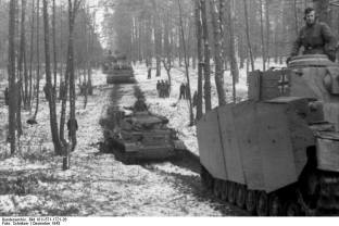 2. SS Panzergrenadier-Division Das Reich. when driving on a road in snow covered forest December 1943.