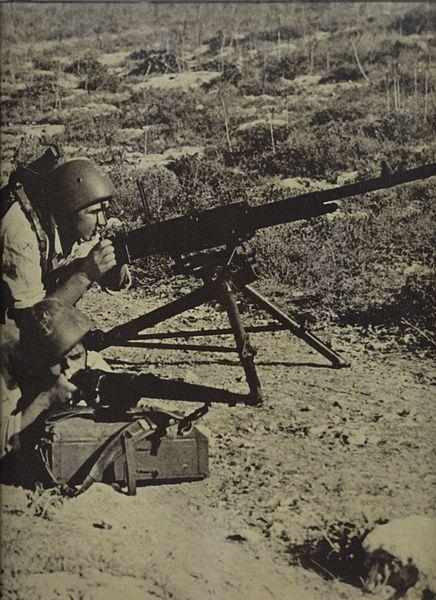 An Italian marines' machine gun team takes position after landing at Sitia.