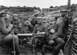 Six German soldiers pose in a in trench with machine gun The machine gun appears to be a Maschinengewehr 08, or MG 08, capable of firing 450-500 rounds a minute.