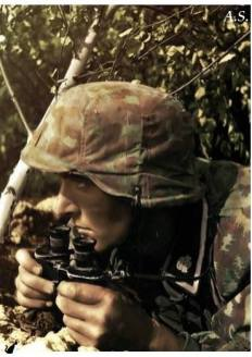 Soldier of the 3rd SS Panzer Division Totenkopf observing enemy movement, in the grounds and surrounding area.
