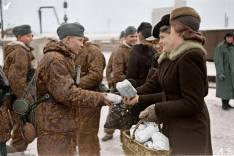 Soldiers of the 20th Waffen grenadier Division of the SS (Estonian Nr. 1), receive gifts prior to departure to the front.