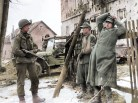 Two young German soldiers surrender to troops of the US 78th Infantry Division during the fighting around the town of Simmerath, Germany on December 15, 1944.