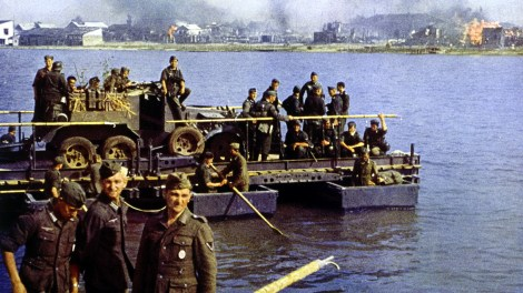 Operation Barbarossa, Summer 1941. A coloured picture of a ferry made out of 8-tonne Brückengerät B (Bridge Equipment B). The vehicle is a turretless Beute Russian BA 10 armored car used as gun tractor. Bruckengerat B was one of the most commonly used German pontoon.