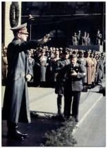 Hitler saluting.