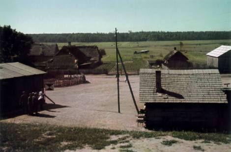 A small Russian village surrounded by forest. The standard in front of the house on the left reveals that the commander of an army corps has set up his headquarters here. In the background is a Fieseler Storch, which was used either to fly the corps commander to visit his front-line units or bring division commanders to him.