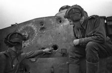 Soviet tankers inspect damage to a Tiger.