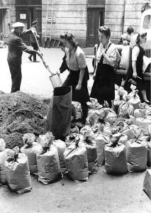 Polish civilians preparing sand bags in the courtyard of townhouse at Moniuszki street, August 1944.