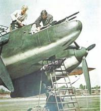 Armorers work on the nose guns of Messerschmitt Bf 110, so formidable when the Zerstörer pilots could bring them to bear.