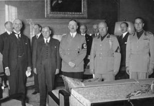Neville Chamberline, Hitler, and Mussolini.