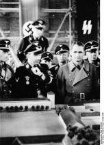 Himmler and Rudolf Hess at Dachau in 1936, viewing a scale model of the camp.