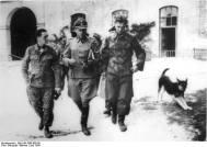 Kurt Meyer (left), Fritz Witt (center)and Max Wünsche (right) in the courtyard of Ardenne Abbey in June 1944.