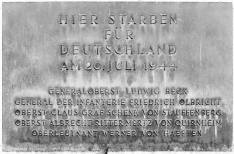"Memorial at the Bendlerblock: ""Here died for Germany on 20 July 1944"" (followed by the names of the principal conspirators)."