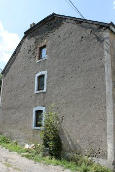 Bullet damaged building near Foy, Belgium.