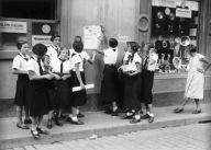 Members of the League of German Girls put up posters for their group, 1933.