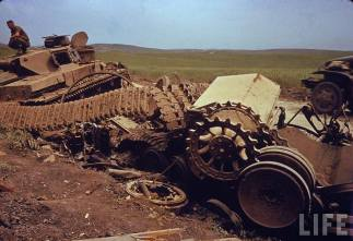 Parts from panzers in North Africa including a disabled Panzer IV.