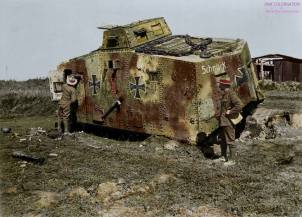 Allied soldiers look at a knocked out panzer.