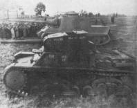 A wooden model of the Jagdtiger, presented to Adolf Hitler on 20 October 1943, can be seen behind the medium Italian tank P 26/40.