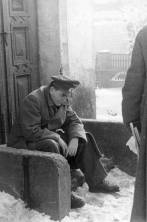 Reichsminister Speer rests on a doorstep.