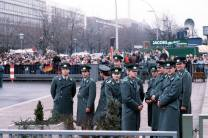 Police cadets of the East German Volkspolizei wait for the official opening of the Brandenburg Gate on 22 December 1989.
