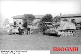 "Panzer VI "" Tiger I ""and Panzerjäger Rhino next to trees in front of two buildings standing between American M4 Sherman tanks in Italy May, 1944."