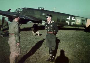 Oberleutnant Walter Grasemann, Staffelkapitän 9/KG 27, in front of Heinkel He.