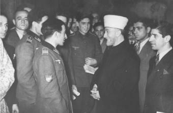 Amin el Husseini the Grand Mufti of Jerusalem, talking to Azerbaijani Legion volunteers in Berlin in December 1942.