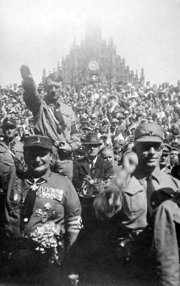 Göring (left) stands in front of Hitler at a Nazi rally in Nuremberg (c. 1928).