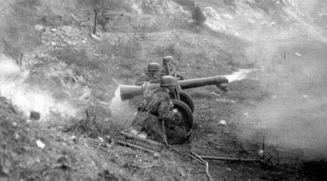 Paratroopers at the baby doll an 8.8cm rocket launcher.