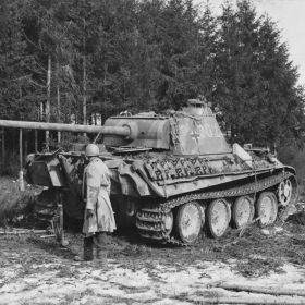 Knocked out Panther inspected by an Allied soldier.