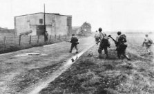 U.S. 30th division advancing near Kohlschied, Germany - October 1944.