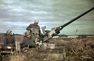 A Lance-Corporal from Finnish 43rd light anti-aircraft divison reloading 40mm Bofors AA-gun already in position near the township of Nokia/Finland, 25 April 1944, during Continuation War.