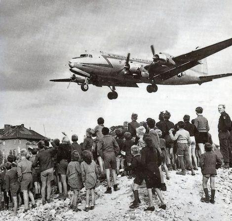Berliners watch a C-54 Skymaster land at Tempelhof Airport, 1948.