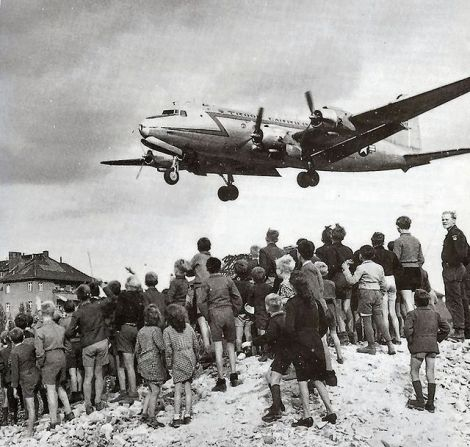 Berliners watch a C-54 Skymaster land at Tempelhof Airport, 1948.