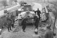 PzKpfw 38 light tank of the 7th Panzerdivision, being used to test of an old bridge. Erwin Rommel, the left side of the picture.