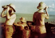 U-177 (Robert Gysae) on patrol in tropical sea. Watch-out is on duty and they were all wearing Tropenhelm a.k.a. pith helmet.