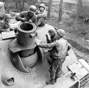 American troops inspecting a knocked out Sturmtiger.