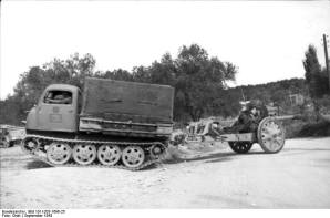 RSO towing 105 mm howitzer.
