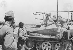 Rommel speaking with his men.