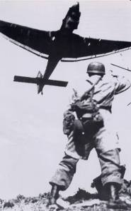 Fallschirmjager waving to Stuka support.