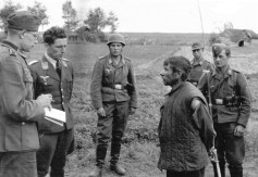 A lieutenant of the paratroopers interrogates a Soviet partisan.