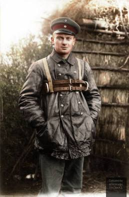 A Zeppelin crewman poses in his leather flying suit and parachute harness.