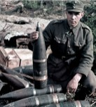 "A Finnish junior sergeant (Alikersantti) inspecting ammunition. The shells seem to be for 152 H/37 heavy howitzer (Soviet 152 mm Gaubitsa-Pushka obr. 1937 g. aka ML-20). The artillery shell under this NCO's hand is captured Soviet OF-540, better known by Finnish Army as ""152 p tkr 36/40-RG"" (152-mm long TNT-filled high explosive shell with 36/40 fuse slot type -RG)."