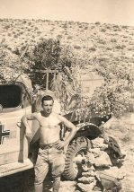 Afrika Korps soldier with captured British truck.