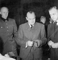 Alfred Rosenberg (right) at the Nuremberg trials, with Hans Frank (centre) and Alfred Jodl.