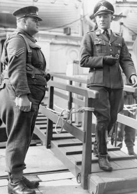 Luftwaffe officer entering captivity in England.