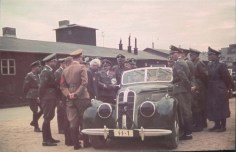 """An official visit of Heinrich Himmler in the Łódź Ghetto, Thursday, 5 June 1941. The grey-haired man is Mordechai Chaim Rumkowski. He was the """"leader"""" of the Jewish community in the Lodz Ghetto (Litzmannstadt). Visible also Himmler's Chief Adjudant Karl Wolff. BTW, In 1987 someone rummaging in a second hand bookstore in Vienna came across a set of about 400 color slides. Upon examination, they turned out to be images of the Lodz ghetto, taken by Walter Genewein, the Nazis' chief accountant."""