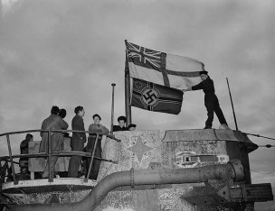 Seamen raise the White Ensign over a captured German U-boat U-190 in St. John's, Newfoundland 1945.
