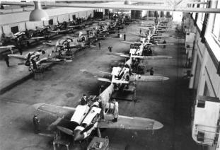 Assembly of Bf 109G-6s in a German aircraft factory.